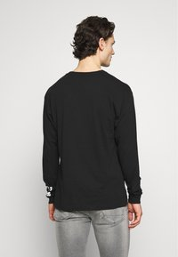 Chi Modu - REALITY - Long sleeved top - black/white - 2