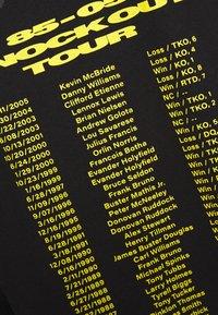 Chi Modu - THE PEOPLES CHAMP 2 - Top sdlouhým rukávem - black/yellow - 5