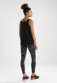 Casall - ESSENTIAL RELAXED TANK - Top - black - 2