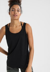 Casall - ESSENTIAL RELAXED TANK - Top - black - 0