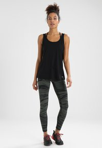 Casall - ESSENTIAL RELAXED TANK - Top - black - 1