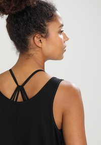 Casall - ESSENTIAL RELAXED TANK - Top - black - 3