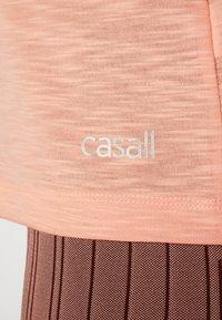 Casall - TEXTURE STRAP RACERBACK - Top - trigger pink - 5