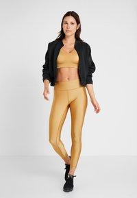 Casall - Leggings - golden metallic - 1