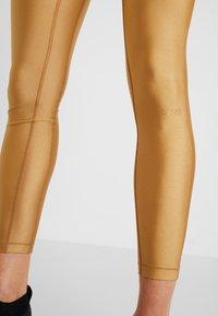 Casall - Leggings - golden metallic - 4