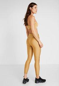 Casall - Leggings - golden metallic - 2