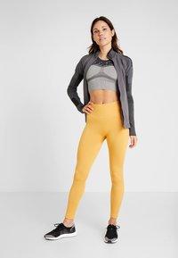 Casall - SEAMLESS CHEVRON - Leggings - golden yellow - 1