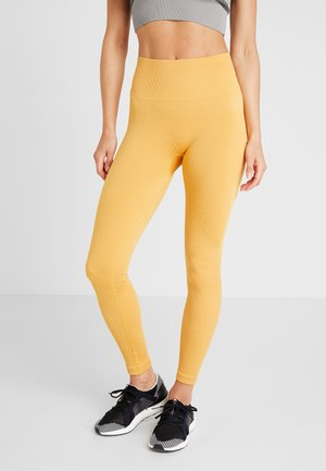 SEAMLESS CHEVRON - Tights - golden yellow