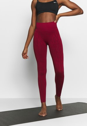 SEAMLESS LEO  - Medias - moving red
