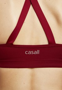Casall - STRAPPY SPORTS BRA - Sports bra - moving red - 6