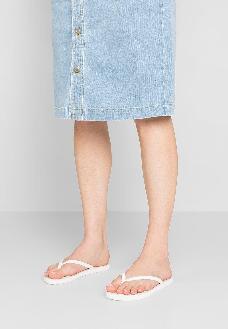 CALANDO - T-bar sandals - white