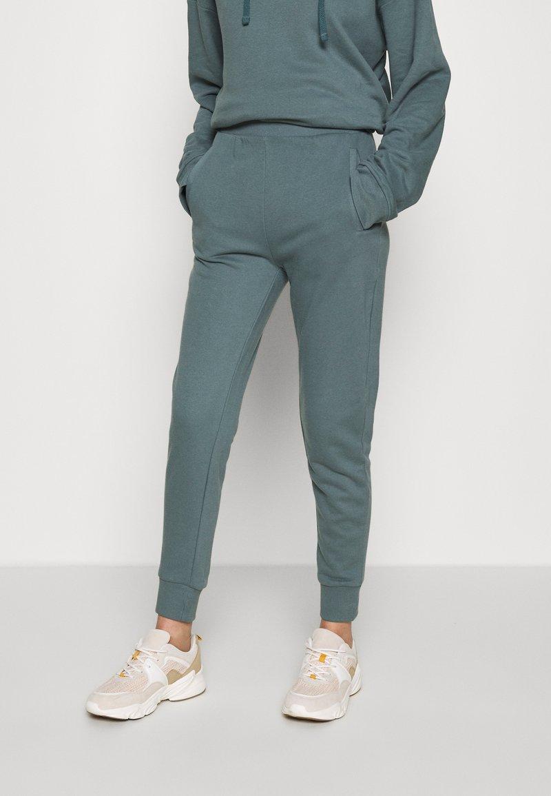 CALANDO - Teplákové kalhoty - goblinblue