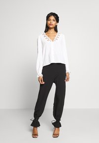 CALANDO - COMFY STRAIGHT LEG TROUSERS - Trousers - black - 1