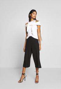 CALANDO - THE COMFY CULOTTE - Trousers - black - 1