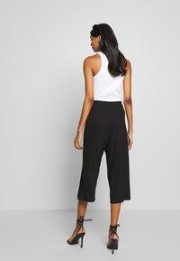 CALANDO - THE COMFY CULOTTE - Trousers - black - 2