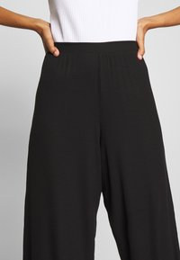 CALANDO - THE COMFY CULOTTE - Trousers - black - 5