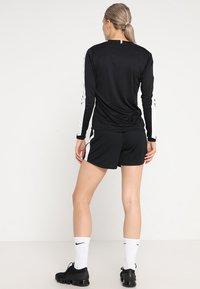 Craft - PROGRESS CONTRAST - Sports shirt - black/white - 2