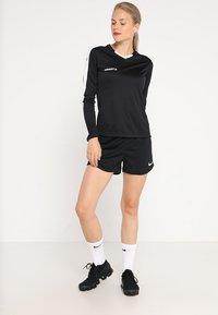 Craft - PROGRESS CONTRAST - Sports shirt - black/white - 1