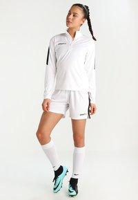 Craft - PROGRESS SHORT CONTRAST - Teamwear - white/black - 1
