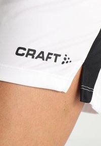 Craft - PROGRESS SHORT CONTRAST - Teamwear - white/black - 5