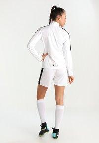 Craft - PROGRESS SHORT CONTRAST - Teamwear - white/black - 2