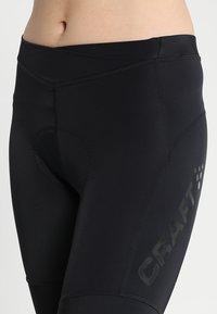 Craft - ESSENCE SHORTS - Leggings - black - 4