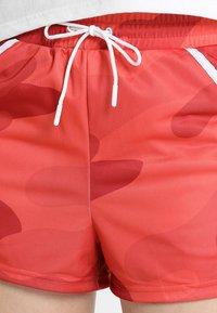 Craft - DISTRICT HIGH WAIST SHORTS - Korte broeken - red/orange - 5
