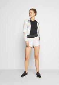 Craft - SHINY SPORT SHORTS - Sports shorts - silver - 1
