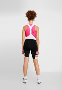 Craft - HALE GLOW BIB SHORTS - Tights - black/fame - 2