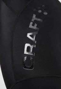 Craft - ESSENCE BIB SHORTS - Leggings - black/white - 6