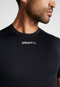 Craft - PRO CONTROL COMPRESSION TEE - T-Shirt print - black - 5