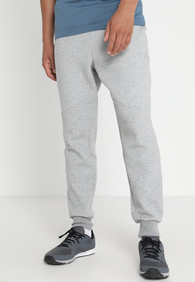 Craft - DISTRICT CROTCH PANTS - Jogginghose - grey melange