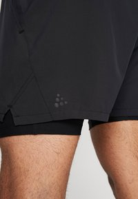 Craft - ADV ESSENCE STRETCH SHORTS - kurze Sporthose - black - 5