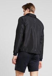 Craft - EAZE WIND - Training jacket - black - 2