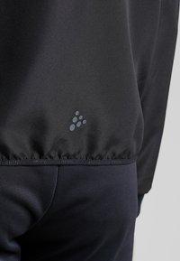 Craft - EAZE WIND - Training jacket - black - 3