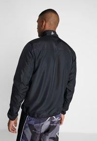 Craft - RUSH - Training jacket - black - 2