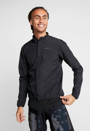 ADOPT RAIN JACKET - Waterproof jacket - black