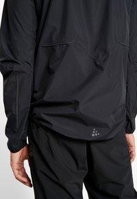 Craft - ADOPT RAIN JACKET - Regenjacke / wasserabweisende Jacke - black - 5