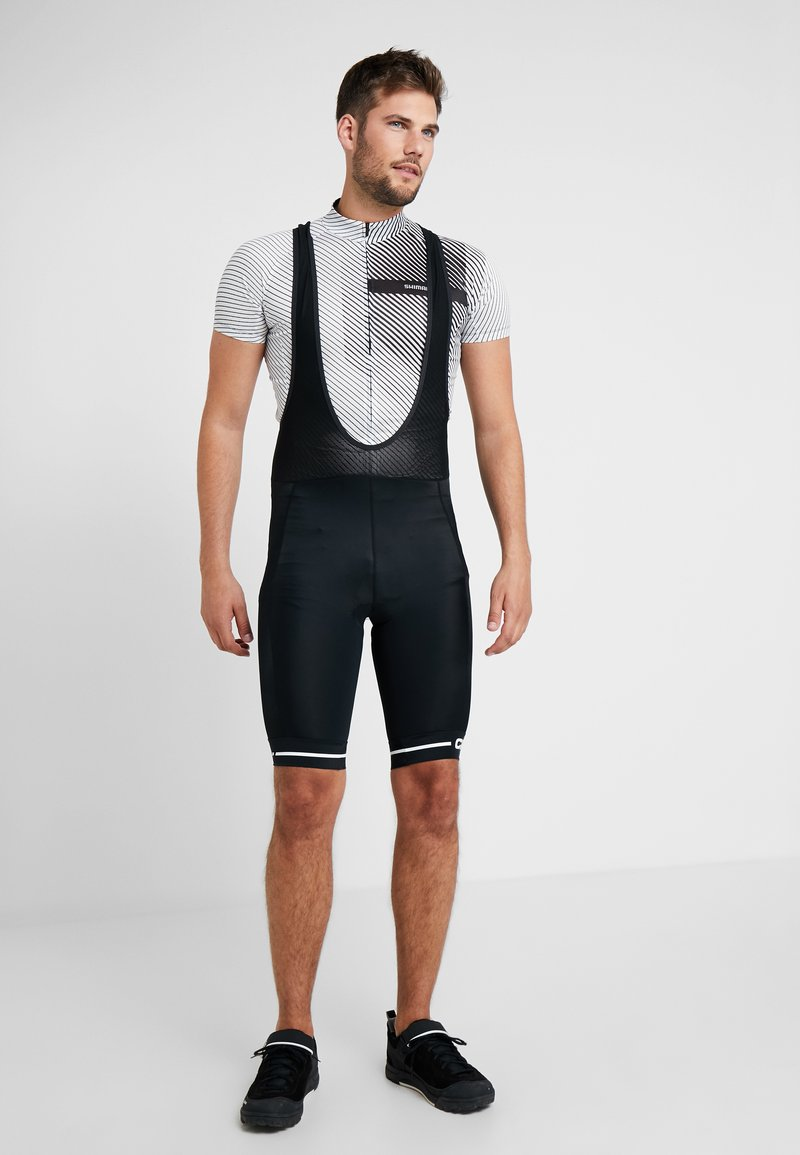Craft - RISE BIB SHORTS - Tights - black