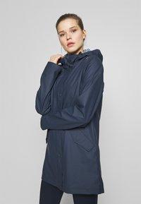 CMP - RAIN JACKET FIX HOOD - Waterproof jacket - black blue - 0