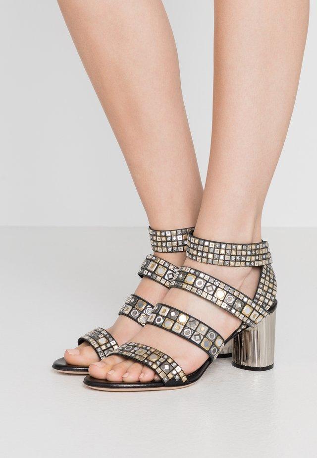 Sandaalit nilkkaremmillä - babilonia/minorca nero