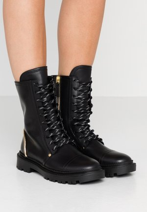 Lace-up ankle boots - nero/gold