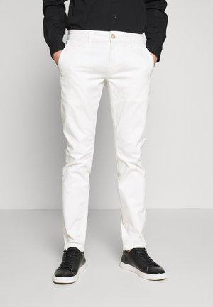 TORINO - Chinos - off white
