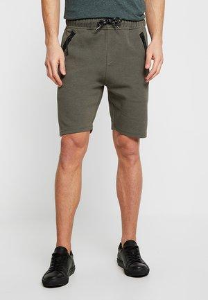 BRAGA - Teplákové kalhoty - army