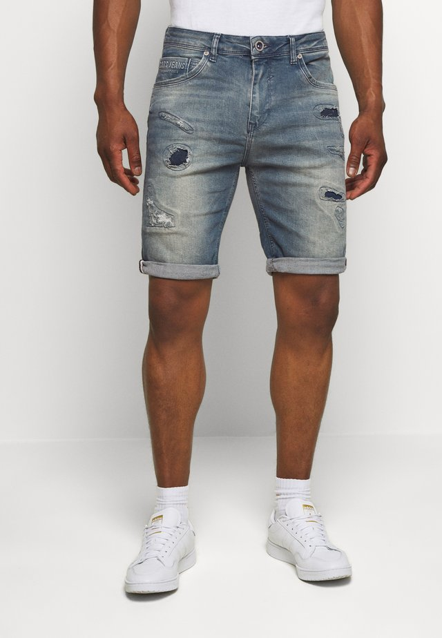 BECKER - Jeans Shorts - lion wash
