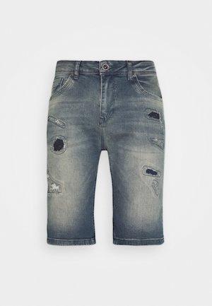 BECKER - Shorts vaqueros - lion wash
