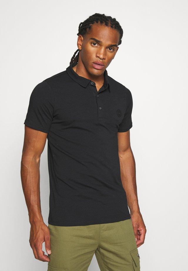 MORRIS - Polo shirt - black