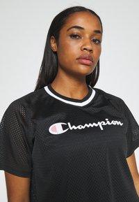 Champion - V NECK - Print T-shirt - black - 3