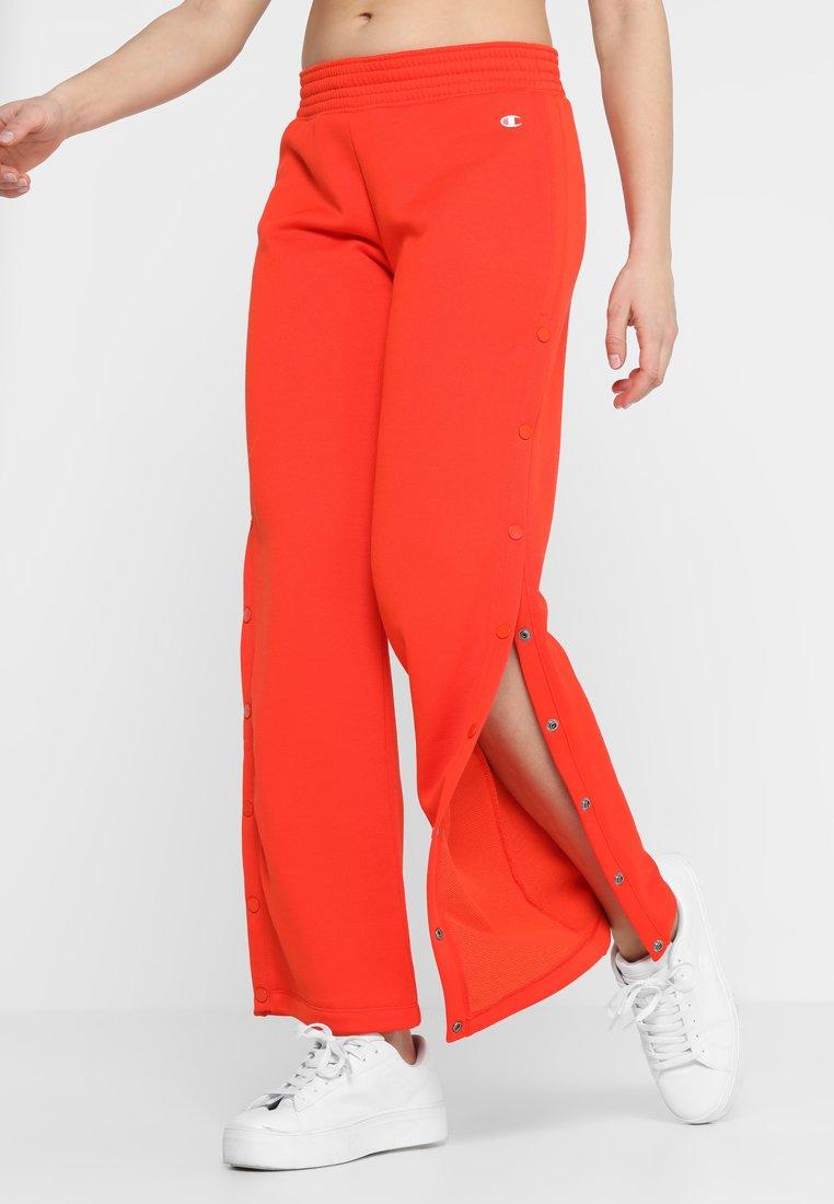 Champion - Teplákové kalhoty - red
