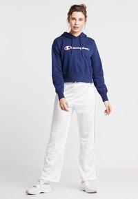 Champion - STRAIGHT PANTS - Tracksuit bottoms - white - 1